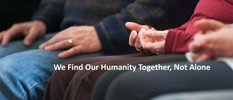 We Find Our Humanity Together, Not Alone (peoples hands who are meditating)
